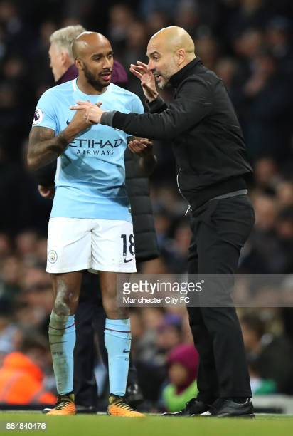 Josep Guardiola Manager of Manchester City gives instructions to Fabian Delph during the Premier League match between Manchester City and West Ham...