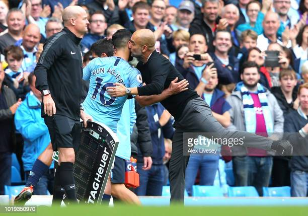 Josep Guardiola Manager of Manchester City greets Sergio Aguero of Manchester City as Sergio Aguero is substituted off during the Premier League...