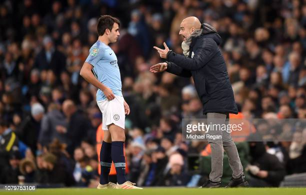 Josep Guardiola Manager of Manchester City in discussion with Eric Garcia during the Carabao Cup Semi Final First Leg match between Manchester City...