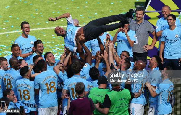 Josep Guardiola Manager of Manchester City is chucked into the air as they team celebrate winning the Premier League after the Premier League match...