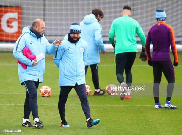 Josep Guardiola Manager of Manchester City is discussion with assistant manager Rodolfo Borrell during a Manchester City training session at...