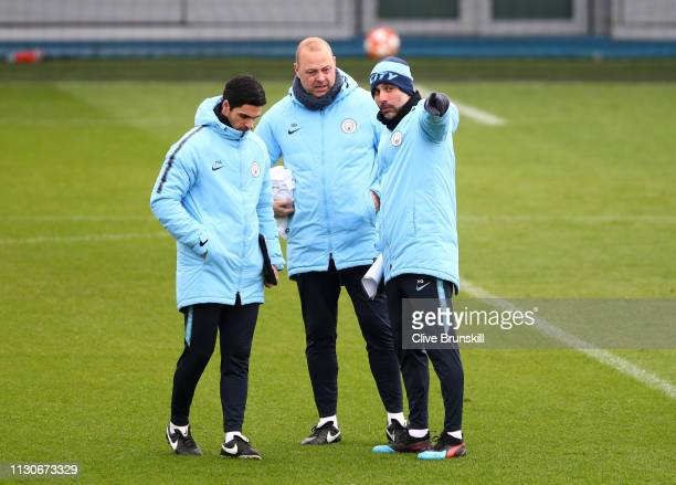 Josep Guardiola Manager of Manchester City is discussion with assistant managers Mikel Arteta and Rodolfo Borrell during a Manchester City training...