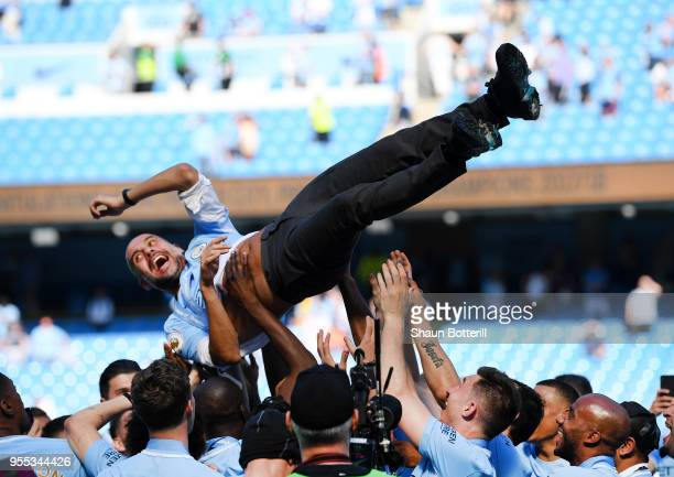 Josep Guardiola Manager of Manchester City is thrown into the air as he and his team celebrate winning the premier league after the Premier League...