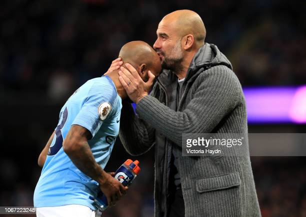 Josep Guardiola Manager of Manchester City kisses Fabian Delph of Manchester City on the head during the Premier League match between Manchester City...