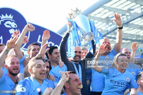 Josep Guardiola, Manager of Manchester City lifts the Premier League Trophy after winning the title during the Premier League match between Brighton...