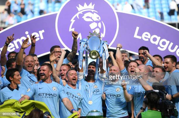 Josep Guardiola Manager of Manchester City lifts The Premier League Trophy after the Premier League match between Manchester City and Huddersfield...