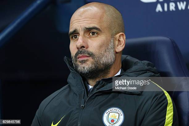 Josep Guardiola Manager of Manchester City looks on during the Premier League match between Manchester City and Watford at Etihad Stadium on December...