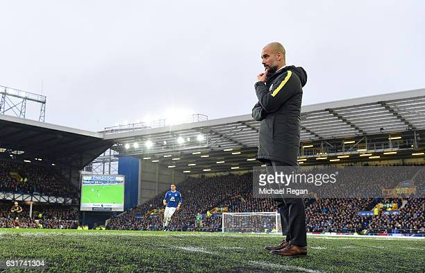 Josep Guardiola Manager of Manchester City looks on during the Premier League match between Everton and Manchester City at Goodison Park on January...