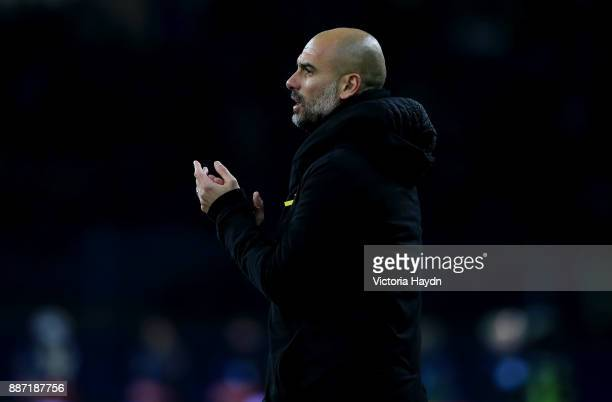 Josep Guardiola Manager of Manchester City looks on during the UEFA Champions League group F match between Shakhtar Donetsk and Manchester City at...