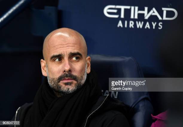 Josep Guardiola Manager of Manchester City looks on prior to the Carabao Cup SemiFinal First Leg match between Manchester City and Bristol City at...