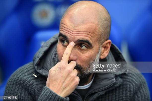 Josep Guardiola Manager of Manchester City looks on prior to the Premier League match between Leicester City and Manchester City at The King Power...
