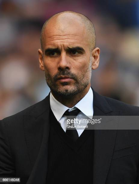 Josep Guardiola Manager of Manchester City looks on prior to the Premier League match between Manchester City and Hull City at Etihad Stadium on...