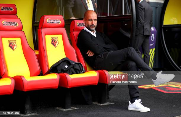 Josep Guardiola manager of Manchester City looks on prior to the Premier League match between Watford and Manchester City at Vicarage Road on...