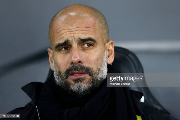 Josep Guardiola Manager of Manchester City looks on prior to the Premier League match between Swansea City and Manchester City at Liberty Stadium on...