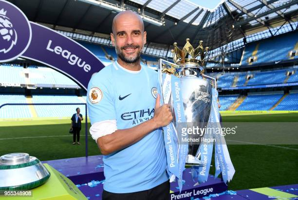 Josep Guardiola Manager of Manchester City poses with The Premier League Trophy after the Premier League match between Manchester City and...