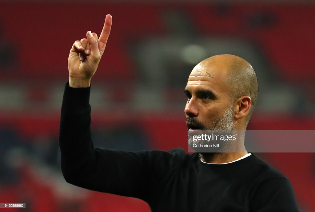 Josep Guardiola, Manager of Manchester City raises one finger to indicate one more game after the Premier League match between Tottenham Hotspur and Manchester City at Wembley Stadium on April 14, 2018 in London, England.