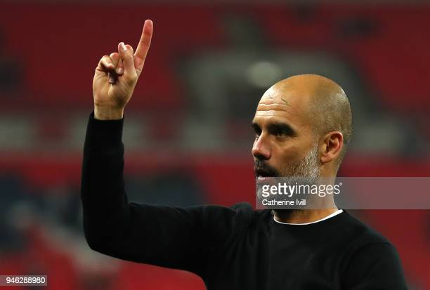 Josep Guardiola Manager of Manchester City raises one finger to indicate one more game after the Premier League match between Tottenham Hotspur and...
