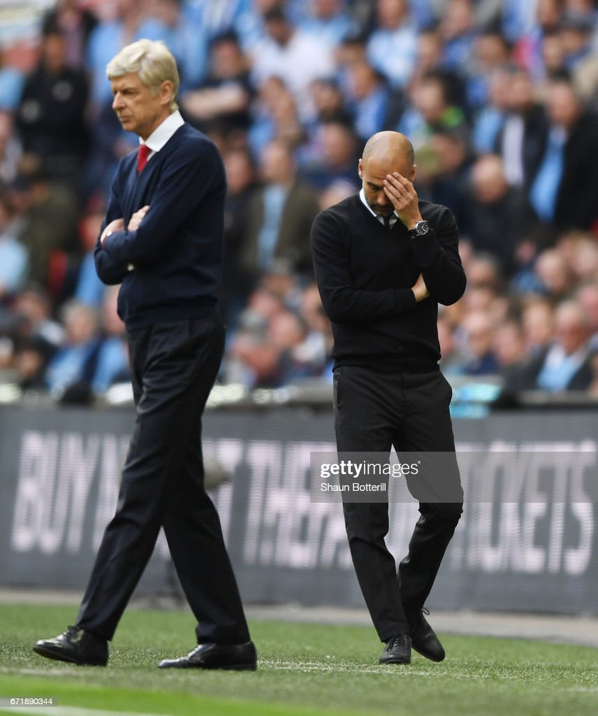 Josep Guardiola manager of Manchester City reacts after Arsenal's first goal during the Emirates FA Cup Semi-Final match between Arsenal and Manchester City at Wembley Stadium on April 23, 2017 in London, England.