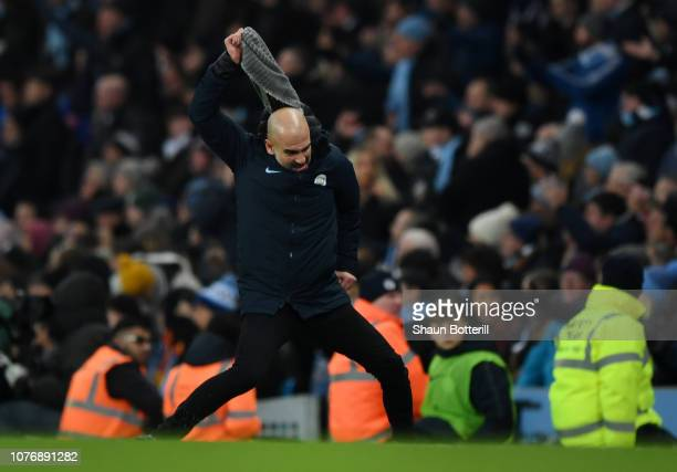 Josep Guardiola Manager of Manchester City reacts by ripping his scarf off during the Premier League match between Manchester City and Liverpool FC...
