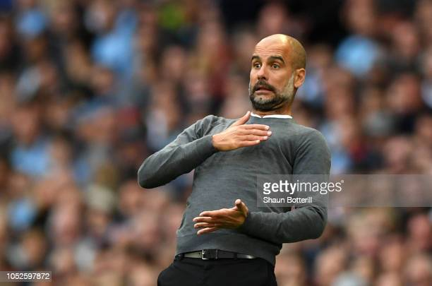 Josep Guardiola Manager of Manchester City reacts during the Premier League match between Manchester City and Burnley FC at Etihad Stadium on October...