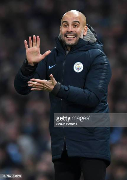 Josep Guardiola Manager of Manchester City reacts during the Premier League match between Manchester City and Liverpool FC at the Etihad Stadium on...