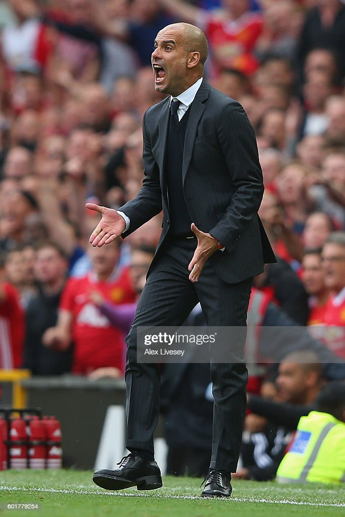 Josep Guardiola, Manager of Manchester City reacts during the Premier League match between Manchester United and Manchester City at Old Trafford on September 10, 2016 in Manchester, England.