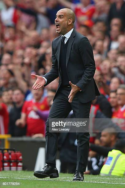 Josep Guardiola Manager of Manchester City reacts during the Premier League match between Manchester United and Manchester City at Old Trafford on...