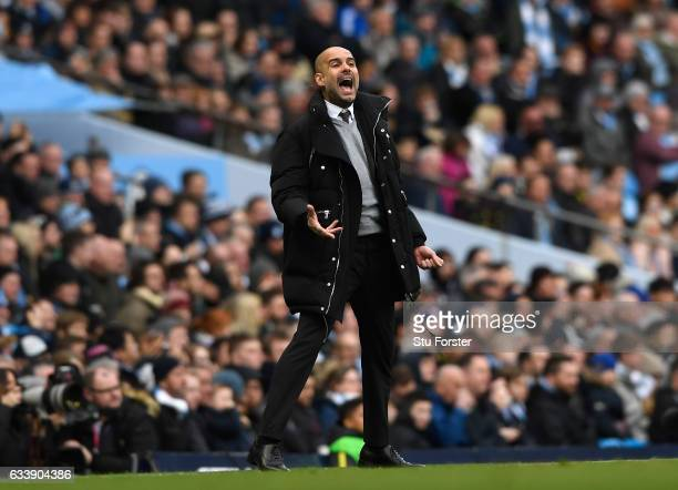 Josep Guardiola Manager of Manchester City reacts during the Premier League match between Manchester City and Swansea City at Etihad Stadium on...