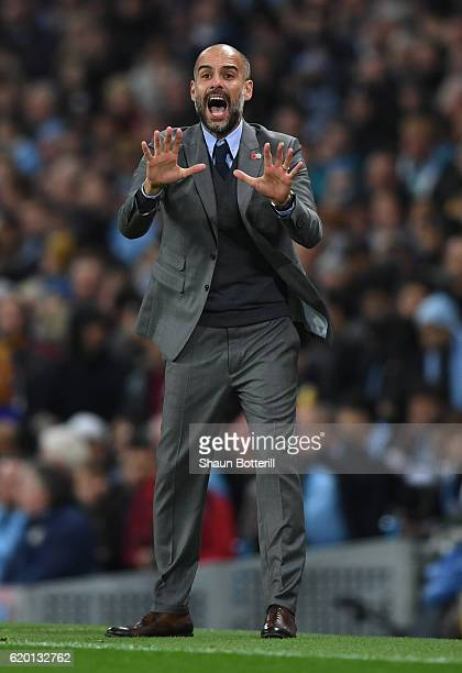 Josep Guardiola manager of Manchester City reacts during the UEFA Champions League Group C match between Manchester City FC and FC Barcelona at...
