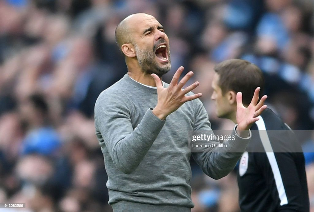 Josep Guardiola, Manager of Manchester City reacts following a missed chance during the Premier League match between Manchester City and Manchester United at Etihad Stadium on April 7, 2018 in Manchester, England.