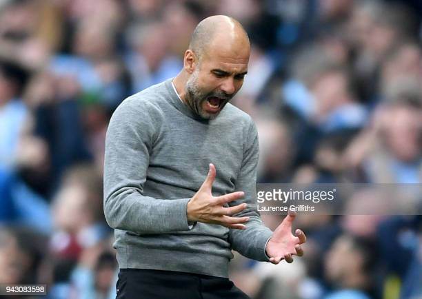 Josep Guardiola Manager of Manchester City reacts following a missed chance during the Premier League match between Manchester City and Manchester...