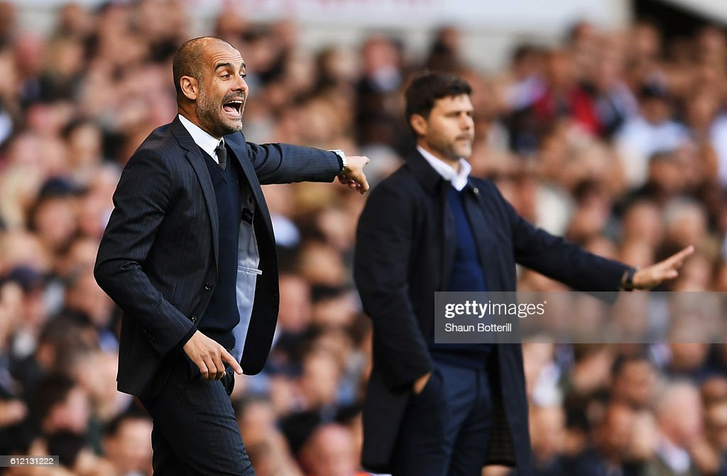 Josep Guardiola, Manager of Manchester City reacts next to Mauricio Pochettino, manager of Tottenham Hotspur during the Premier League match between Tottenham Hotspur and Manchester City at White Hart Lane on October 2, 2016 in London, England.