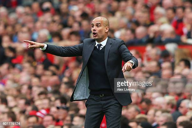 Josep Guardiola Manager of Manchester City reacts on the sidelines during the Premier League match between Manchester United and Manchester City at...