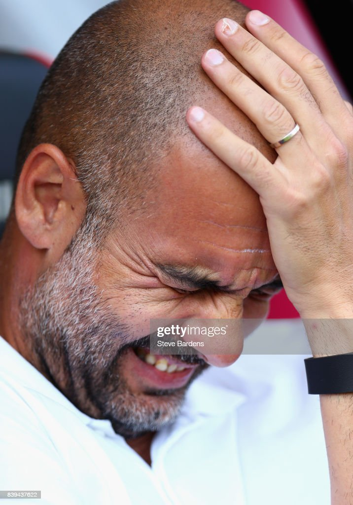 Josep Guardiola, Manager of Manchester City reacts prior to the Premier League match between AFC Bournemouth and Manchester City at Vitality Stadium on August 26, 2017 in Bournemouth, England.