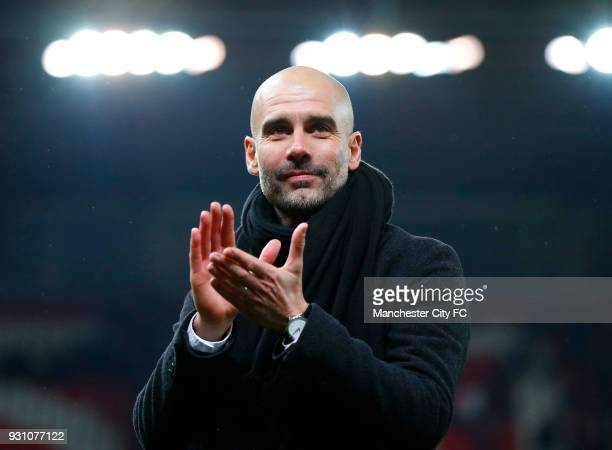 Josep Guardiola Manager of Manchester City salutes the travelling fans after the Premier League match between Stoke City and Manchester City at...
