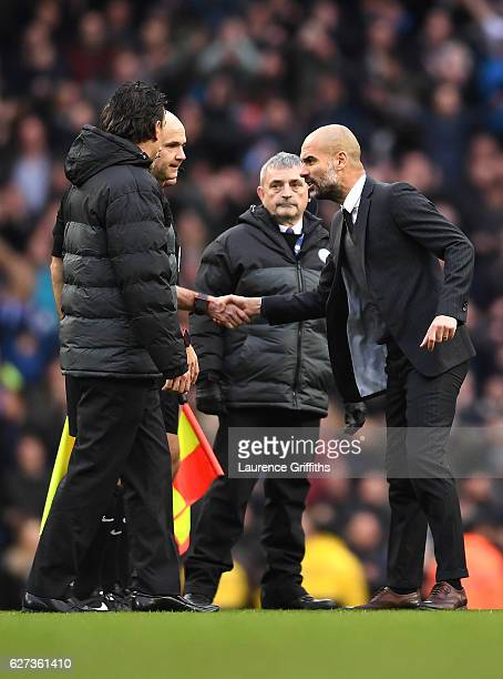Josep Guardiola Manager of Manchester City shakes hands with referee Anthony Taylor after his team's 13 defeat in the Premier League match between...