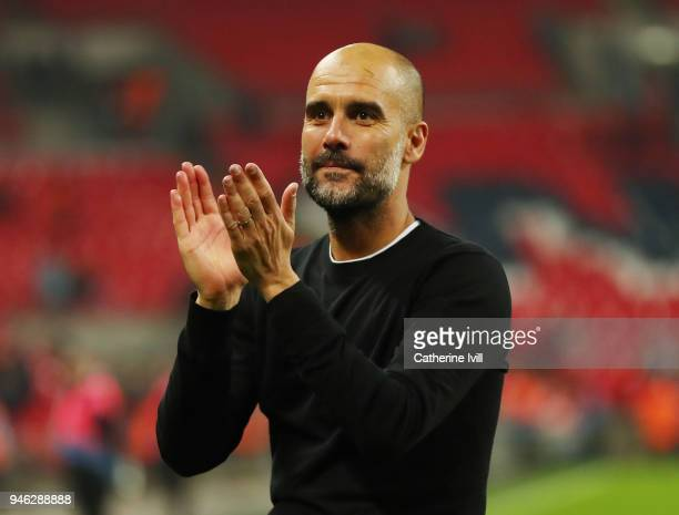 Josep Guardiola Manager of Manchester City shows appreciation to the fans after the Premier League match between Tottenham Hotspur and Manchester...