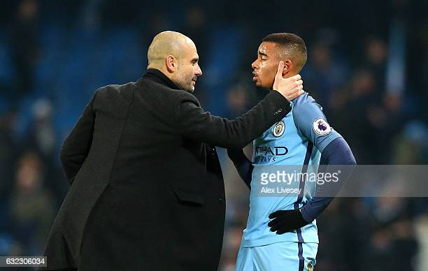 Josep Guardiola Manager of Manchester City speaks to Gabriel Jesus of Manchester City on the pitch after the Premier League match between Manchester...