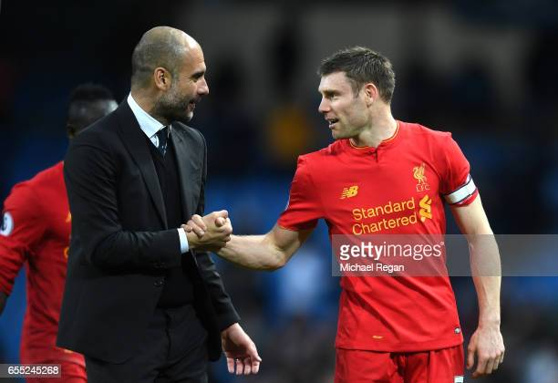 Josep Guardiola Manager of Manchester City speaks to James Milner of Liverpool after the Premier League match between Manchester City and Liverpool...