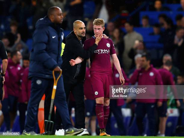 Josep Guardiola Manager of Manchester City speaks to Kevin De Bruyne of Manchester City after the Premier League match between Chelsea and Manchester...