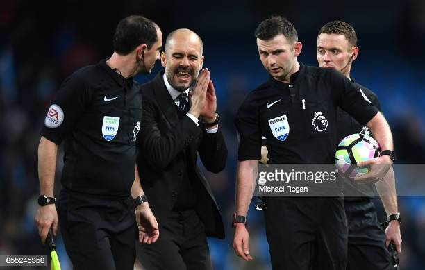 Josep Guardiola Manager of Manchester City speaks to referee Michael Oliver after the Premier League match between Manchester City and Liverpool at...