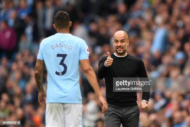 Josep Guardiola Manager of Manchester City speaks with Danilo during the Premier League match between Manchester City and Swansea City at Etihad...