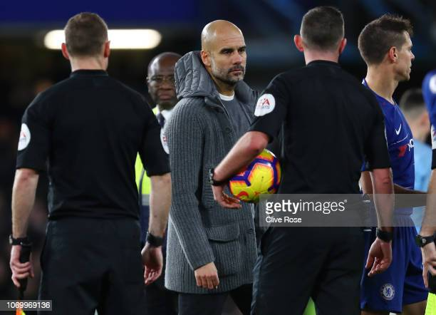 Josep Guardiola Manager of Manchester City stares at referee Michael Oliver after the Premier League match between Chelsea FC and Manchester City at...