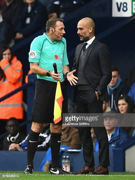 Josep Guardiola Manager of Manchester City talks to an assistant referee during the Premier League match between West Bromwich Albion and Manchester...