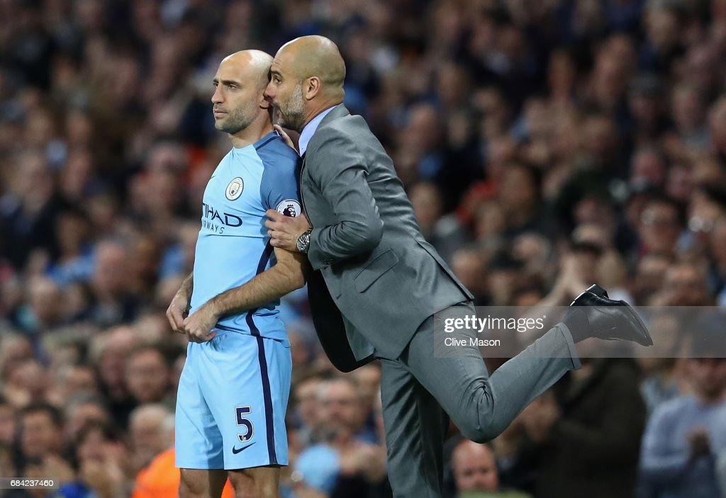 https://media.gettyimages.com/photos/josep-guardiola-manager-of-manchester-city-talks-with-pablo-zabaleta-picture-id684237460