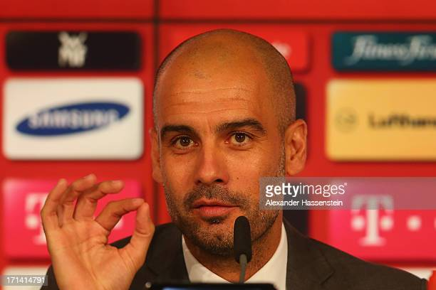 Josep Guardiola new head coach of FC Bayern Muenchen talks to the media during his official presentation at the Allianz Arena on June 24 2013 in...