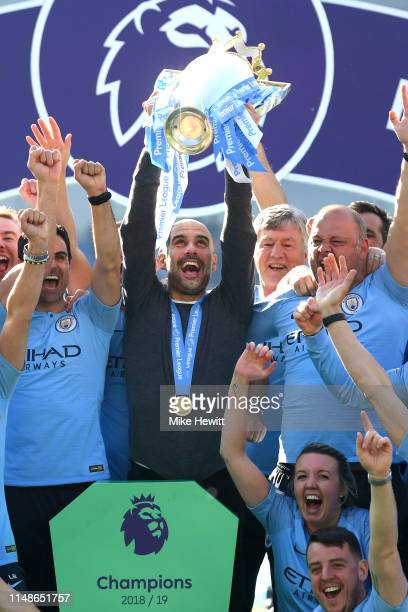 Josep Guardiola of Manchester City lifts the Premier League Trophy after winning the title during the Premier League match between Brighton & Hove...