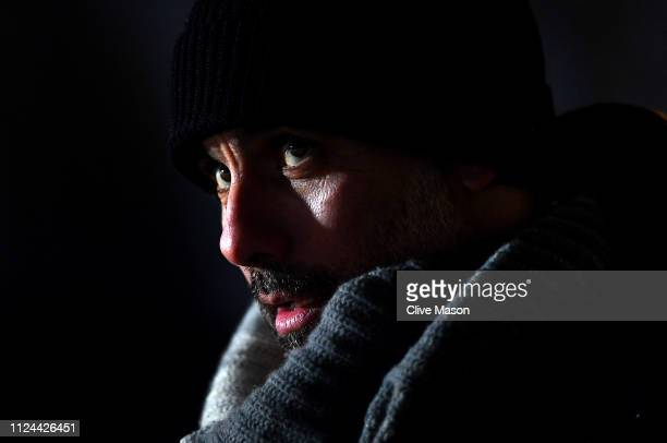 Josep Guardiola of Manchester City looks on during warm up before the Carabao Cup Semi Final Second Leg match between Burton Albion and Manchester...