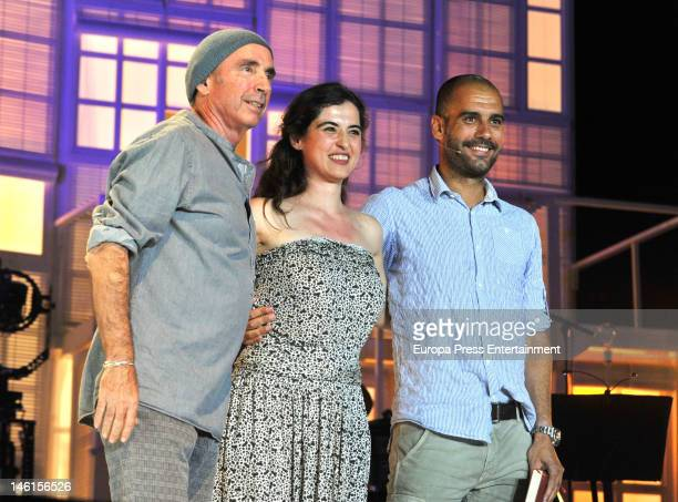 Josep Guardiola , Silvia Perez and Lluis Llach are seen singing a son during a charity concert against AIDS at Palau Sant Jordi on June 8, 2012 in...