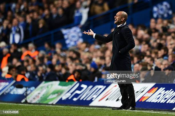 Josep Guardiola the Barcelona manager shouts instructions to his players during the UEFA Champions League Semi Final first leg match between Chelsea...